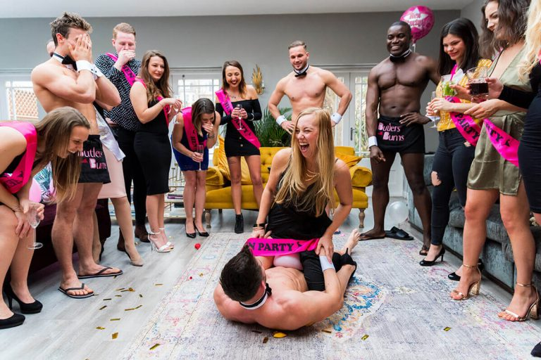 Naked butlers playing a game with our customers at a party